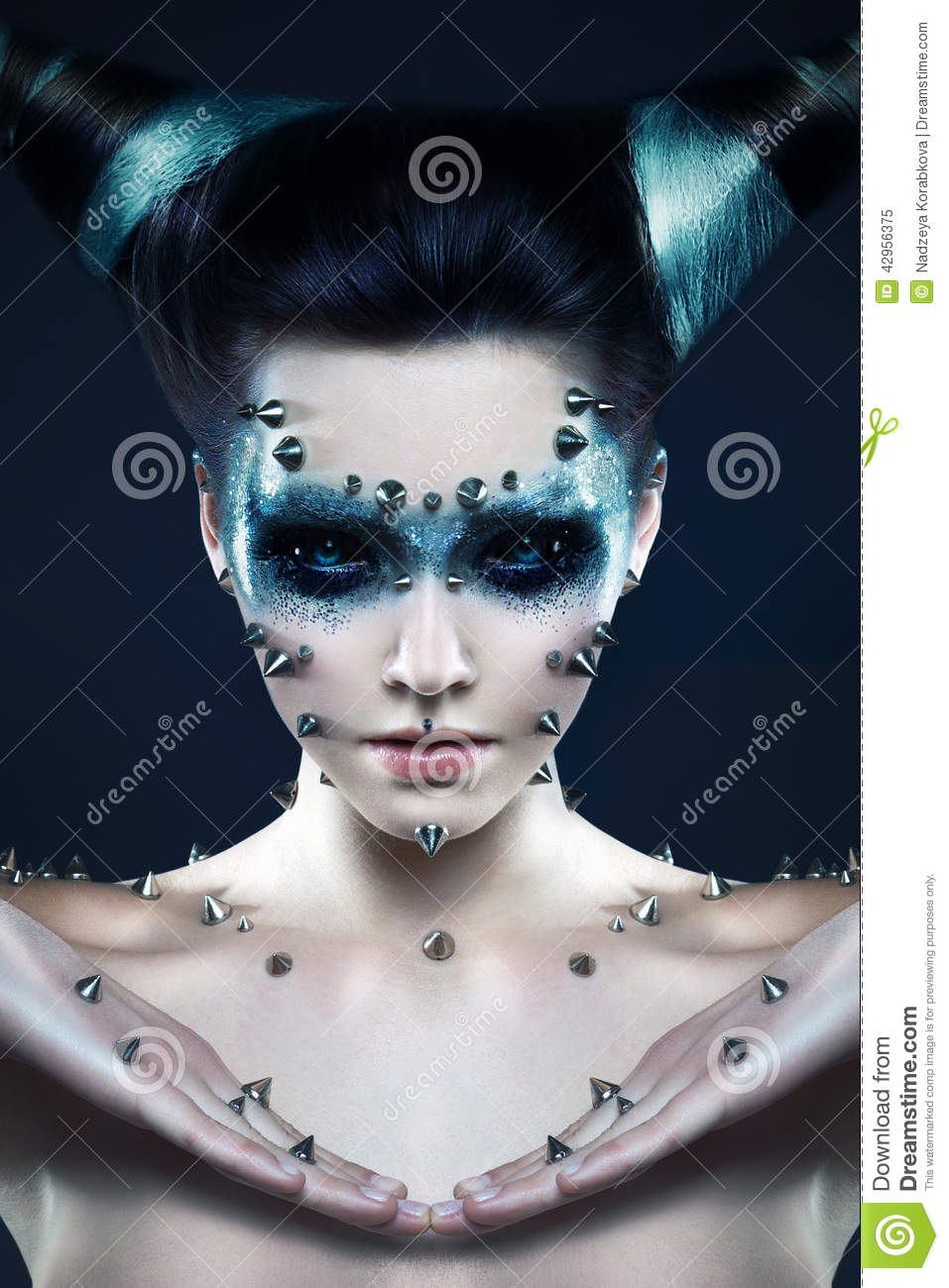 Demon Girl With Spikes On The Face And Body Stock Photo