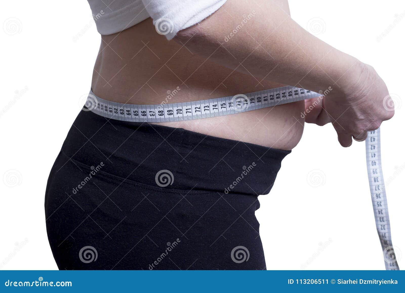 Den feta flickan mäter formatet av midjabegreppet av förlorande vikt Klockadiagram Mäta bandet runt om midjan