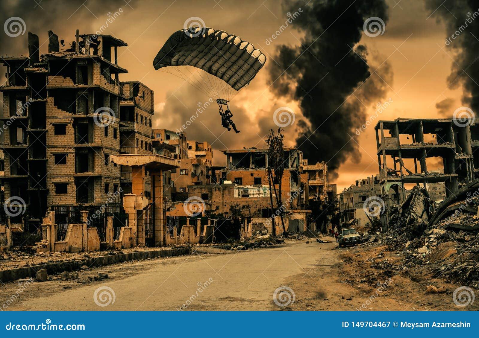 Den militära soldaten med hoppa fallskärm i förstörd stad