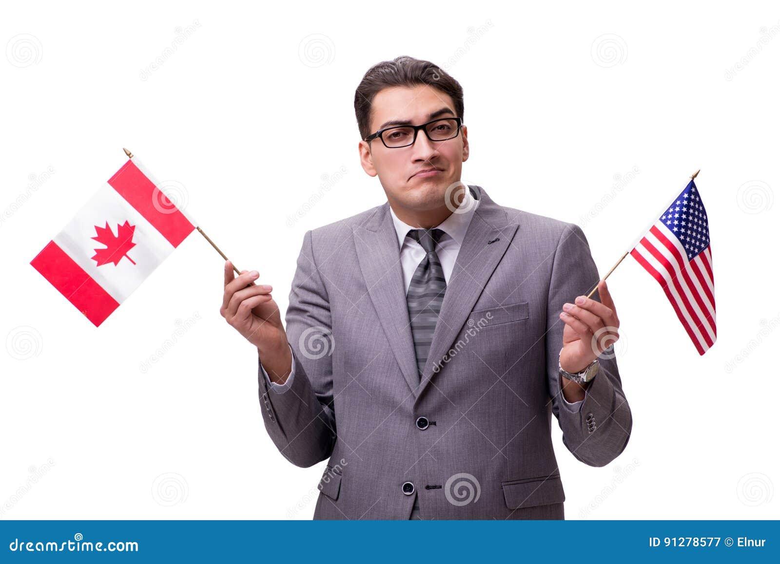 Den unga affärsmannen med flaggan som isoleras på vit