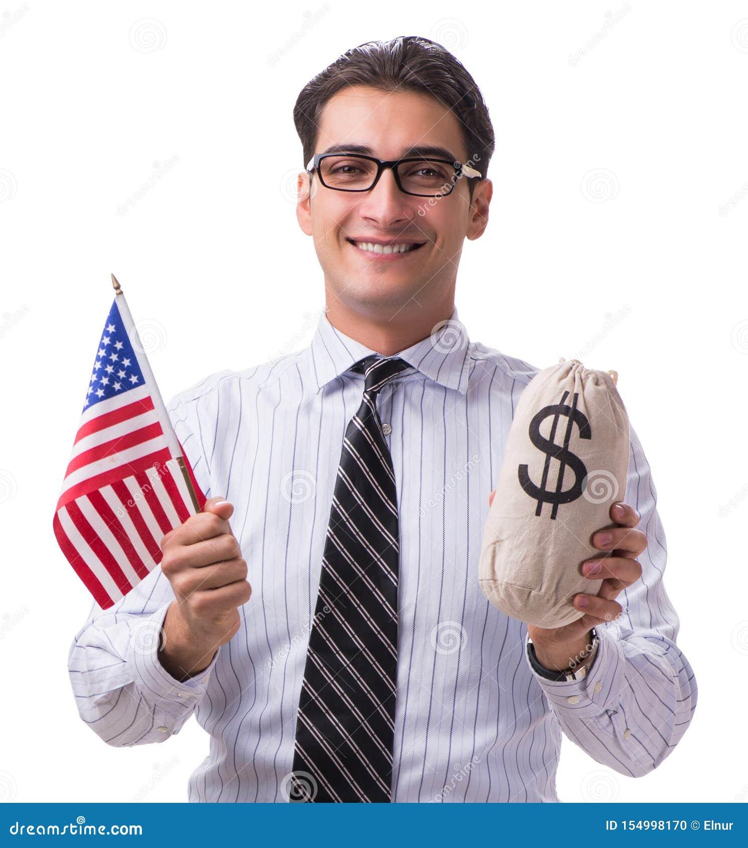 Den unga aff?rsmannen med amerikanska flaggan och pengar plundrar p? vit