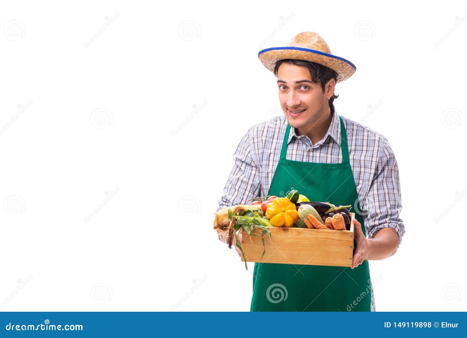 Den unga bonden med ny jordbruksprodukter som isoleras p? vit bakgrund