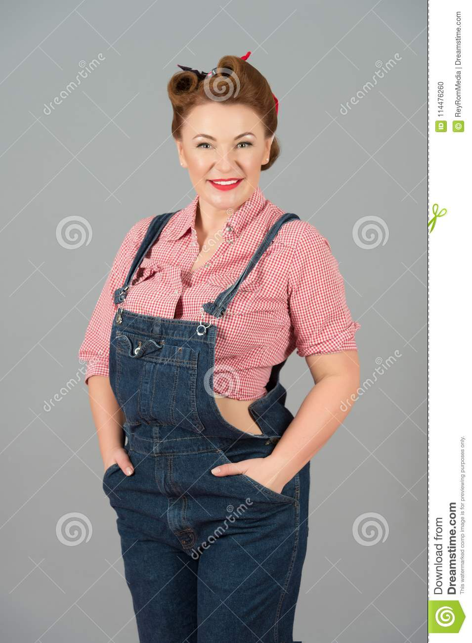 Denim Dress And Pin Up Style Repair Woman Isolated In Studio On Grey