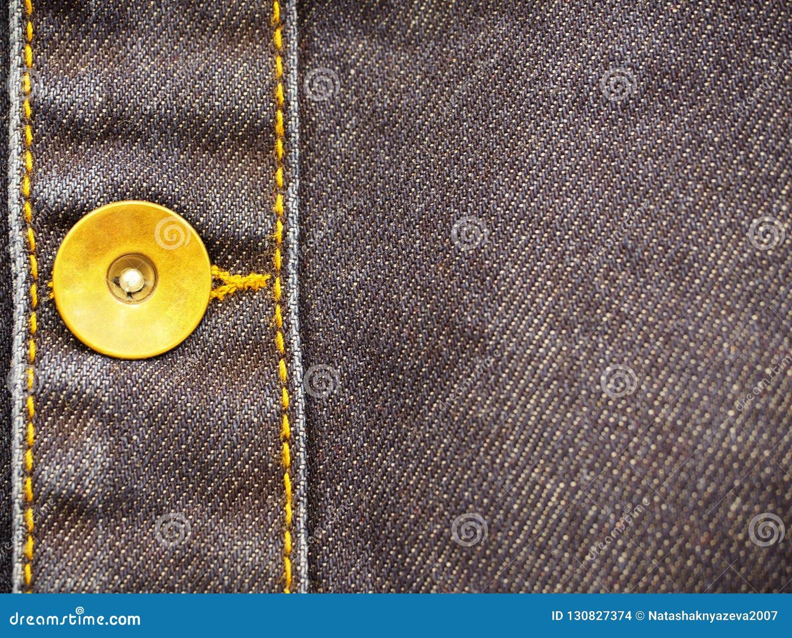 Denimeinzelteil mit Knopfnahaufnahme, als Hintergrund