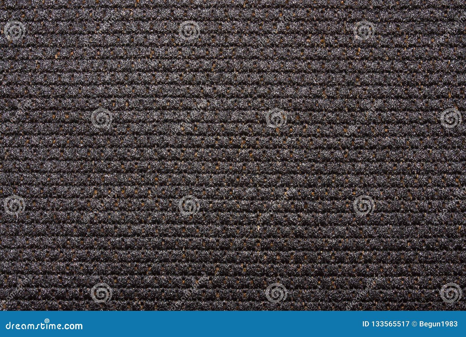 Dense black braided fabric texture.