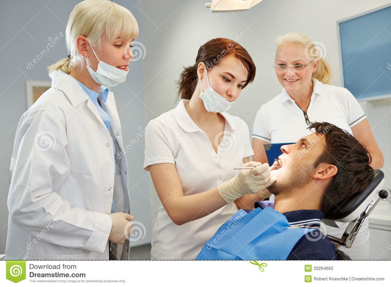 http://thumbs.dreamstime.com/z/dental-assistant-taking-approbation-test-two-dentists-33264662.jpg