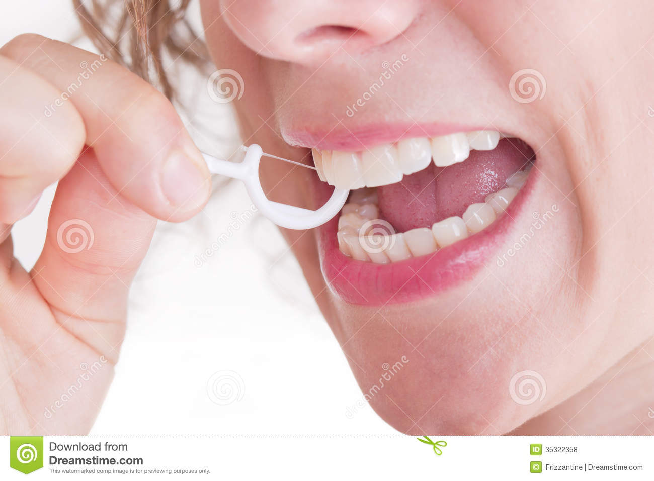 dental-care-dental-floss-woman-her-teeth-35322358.jpg