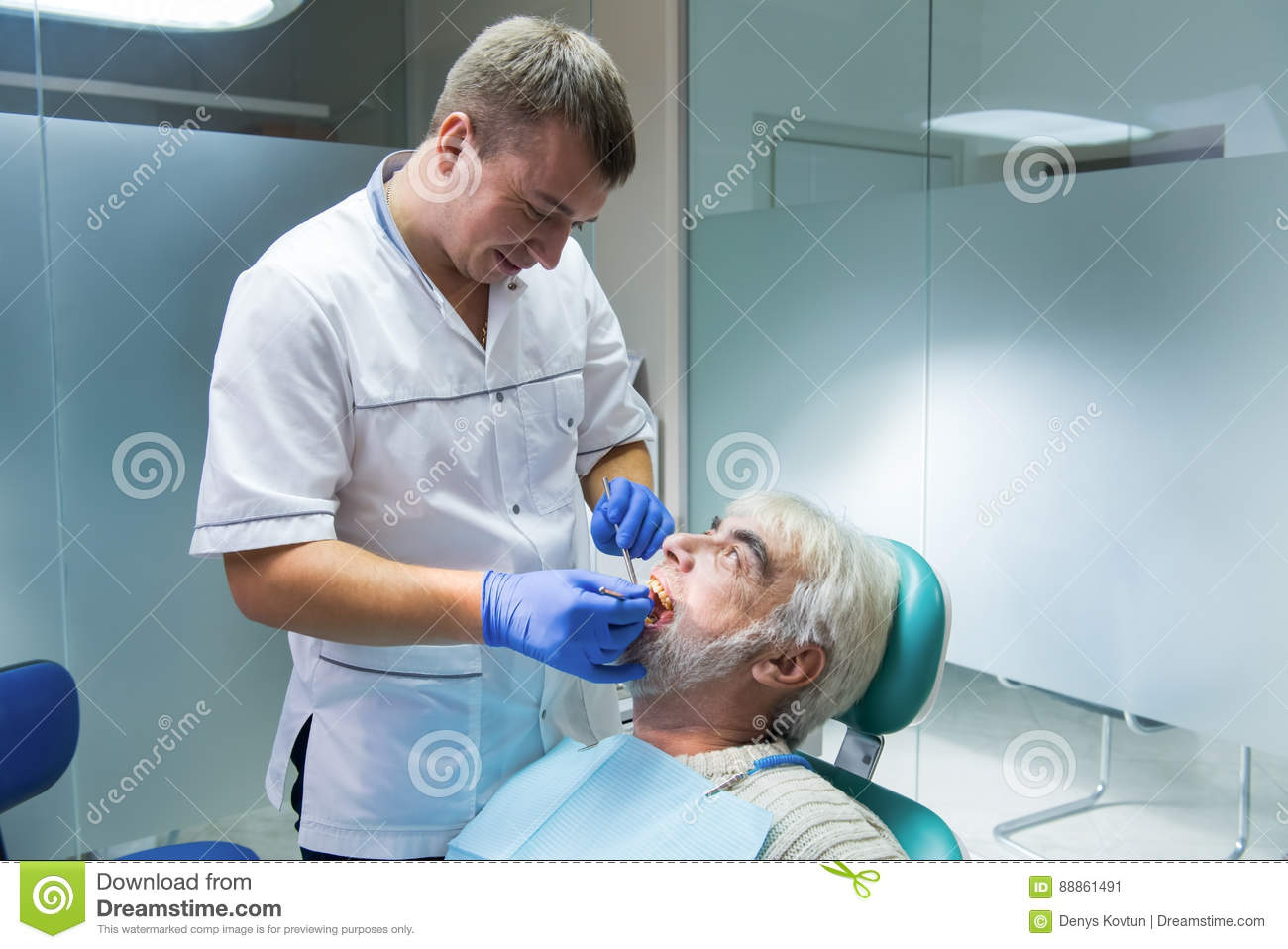 Dental doctor with senior patient.