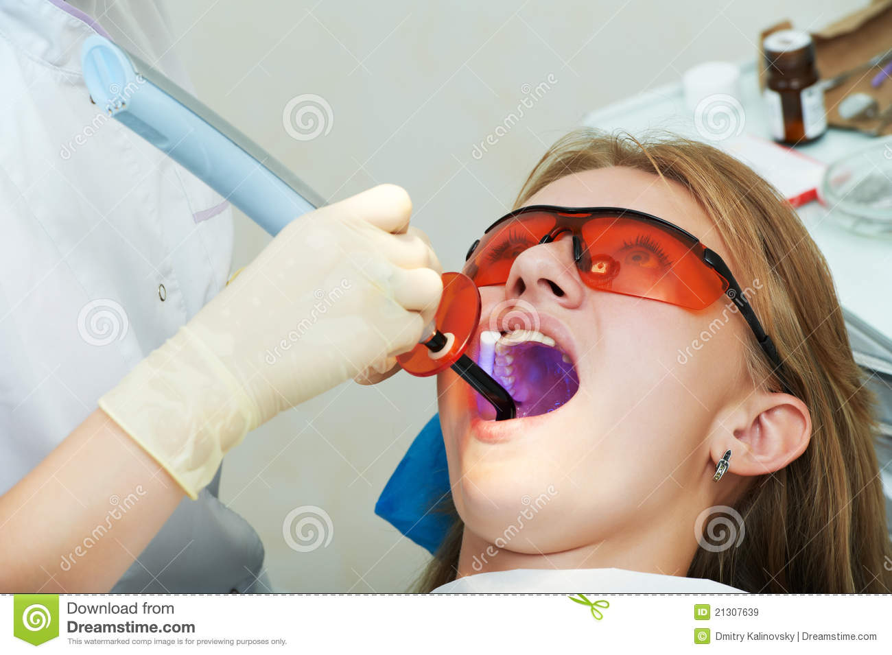 Dental Filing Of Child Tooth By Ultraviolet Light Stock