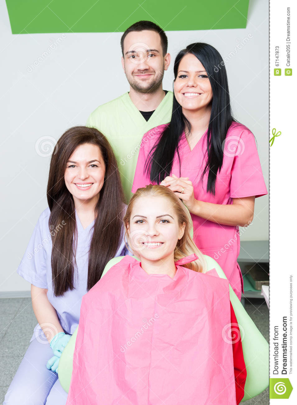 Dentist doctor and assistants in dental office