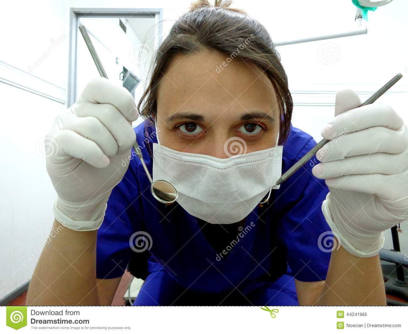 Dentist With Gloves Mask Mirror And Explorer Stock Image