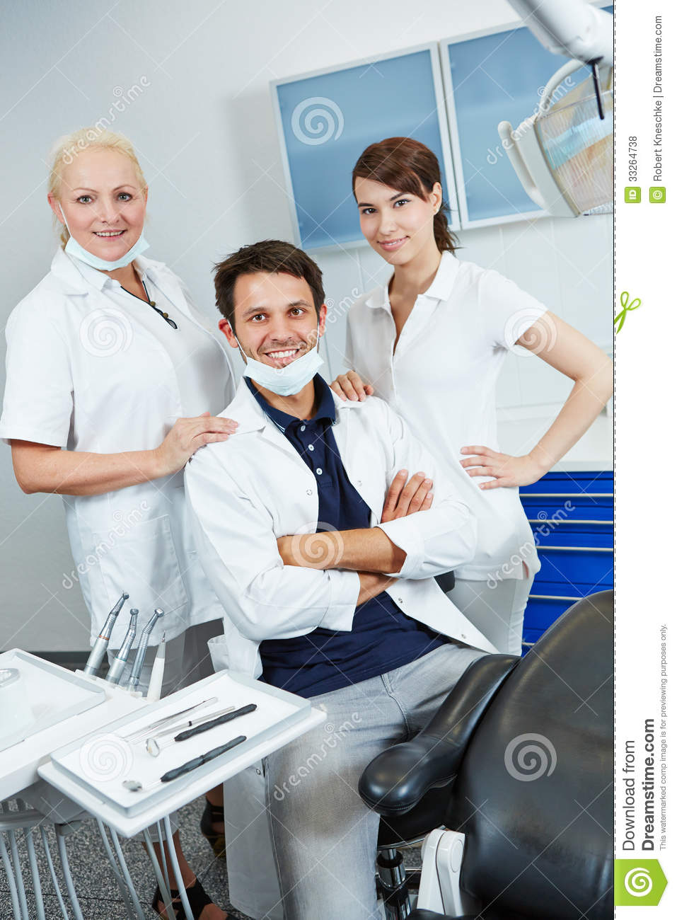 Dentist with group of dental assistants