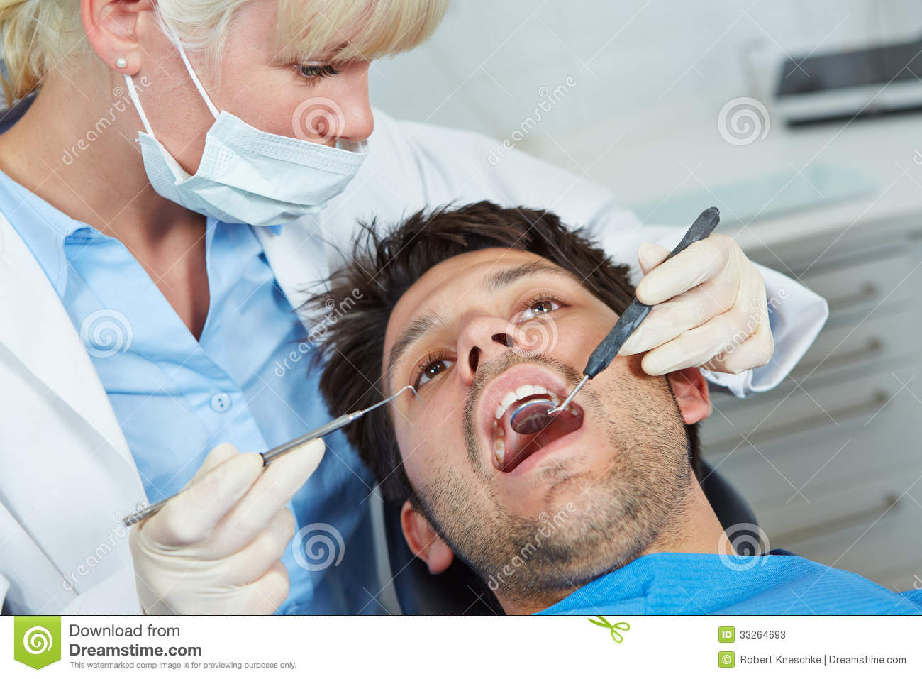 Dentist with mirror and probe