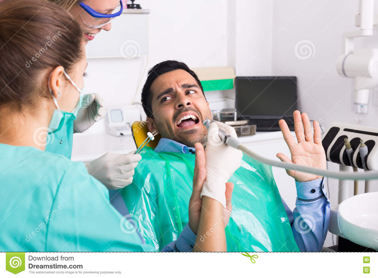 Dentist and scared patient