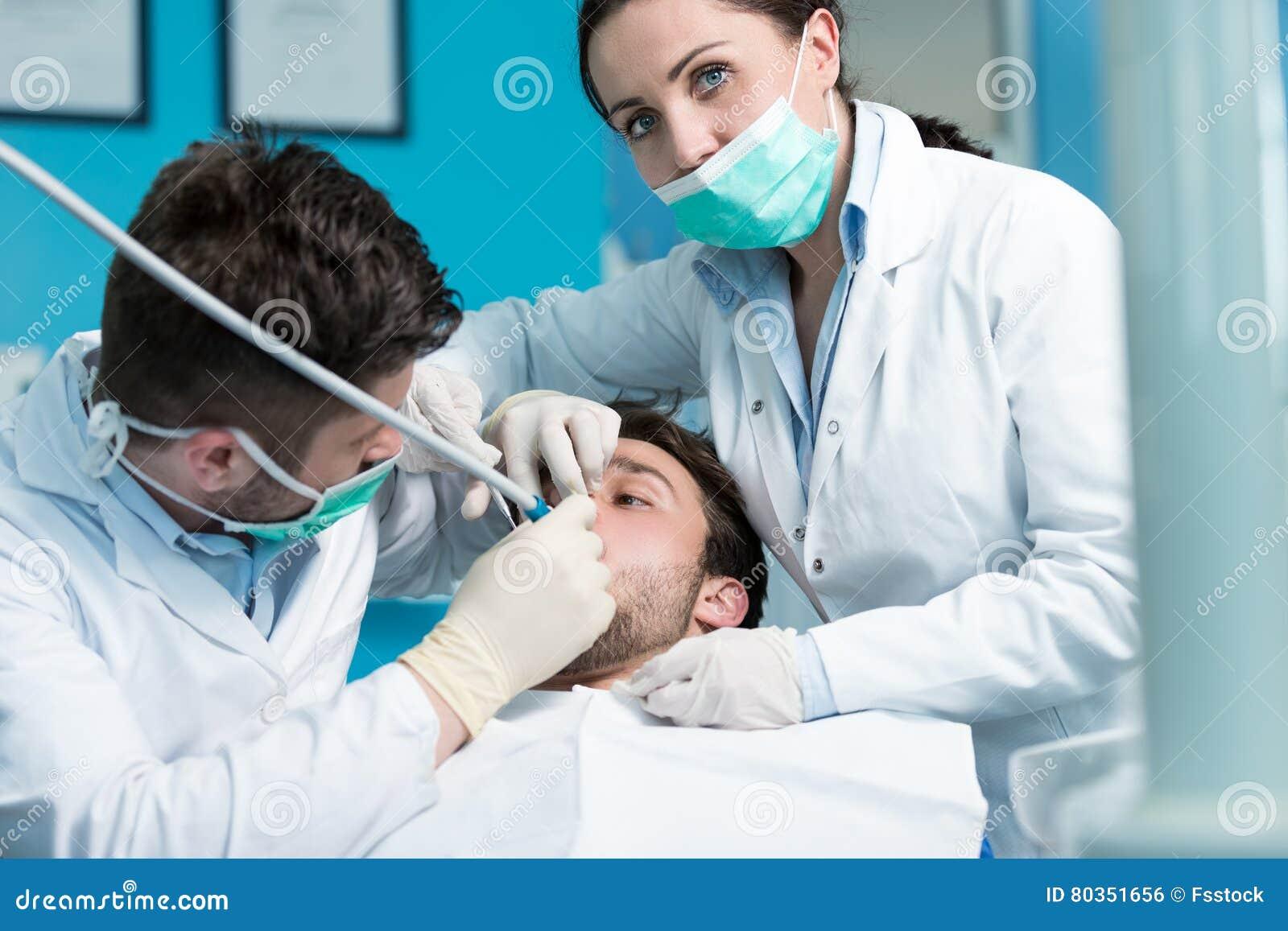 Dentistry education. Male dentist doctor teacher explaining treatment procedure.