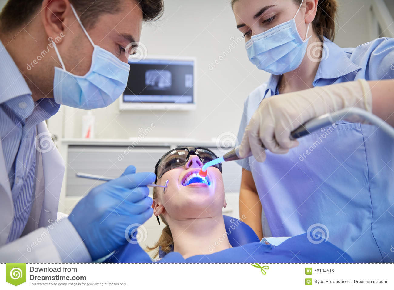 Teenage Patient Dentist Woman With Dental Assistant Stock