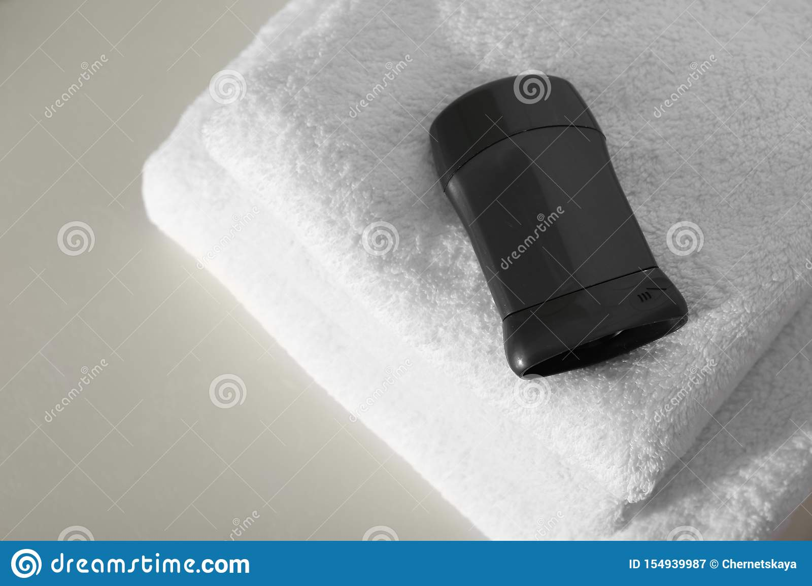 Deodorant with clean towels on light above view. Space for text