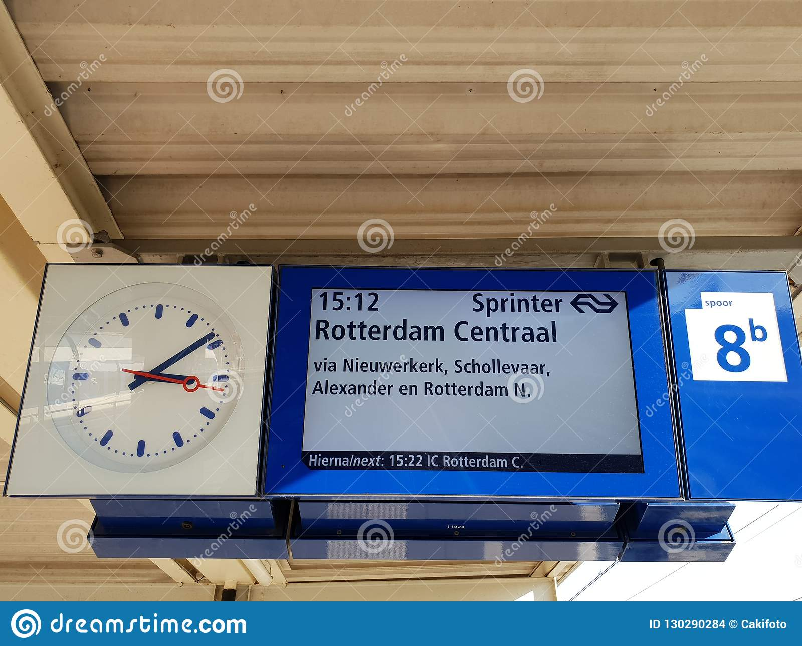 Departure board on the platform of railway station Gouda, train is heading to Rotterdam in the Netherlands.