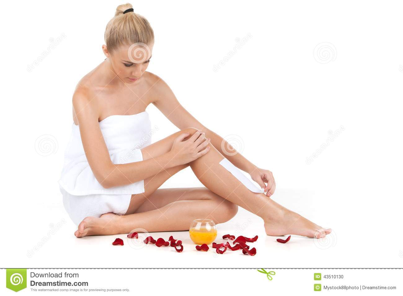 Depilation Of Female Legs With Waxing On White Background