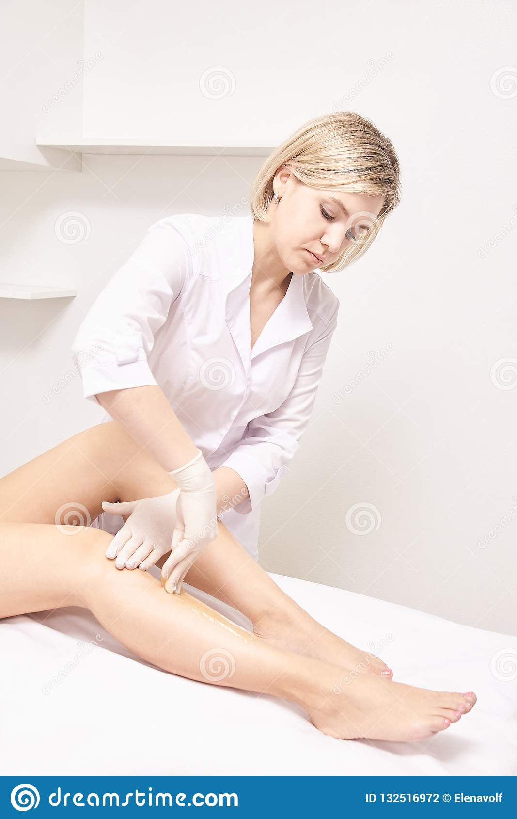 Depilation spa procedure. Woman hair remove waxing. Epilation sugaring. Legs foot