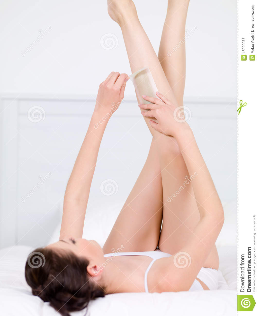 Depilation of woman s legs by waxing
