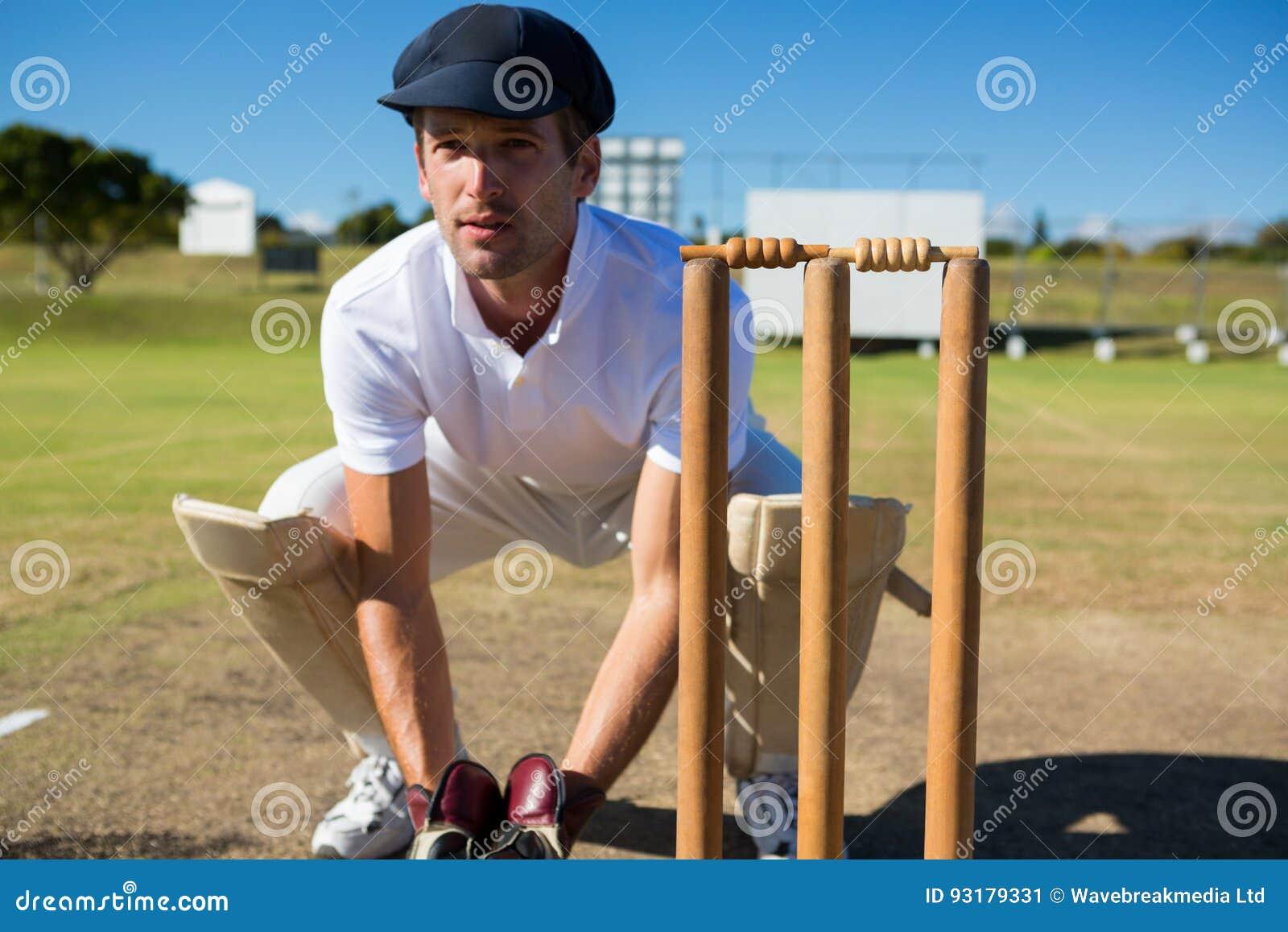 Depositário do wicket que agacha-se por cotoes durante o fósforo