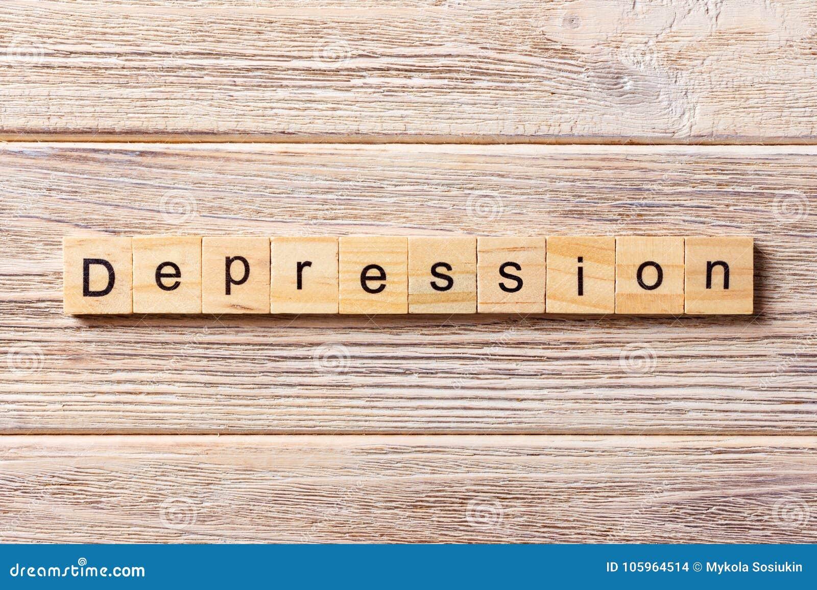 Depresji słowo pisać na drewnianym bloku Depresja tekst na stole, pojęcie