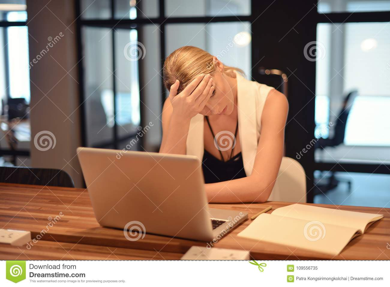 Depressed business blonde woman having troubles with her works