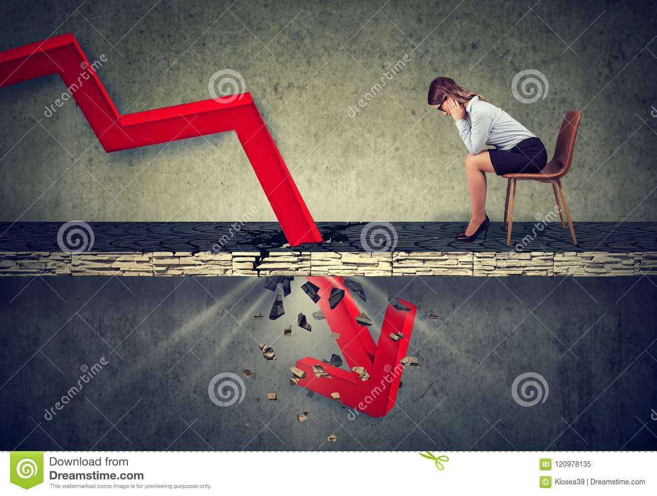 Depressed business woman looking down at the falling red arrow