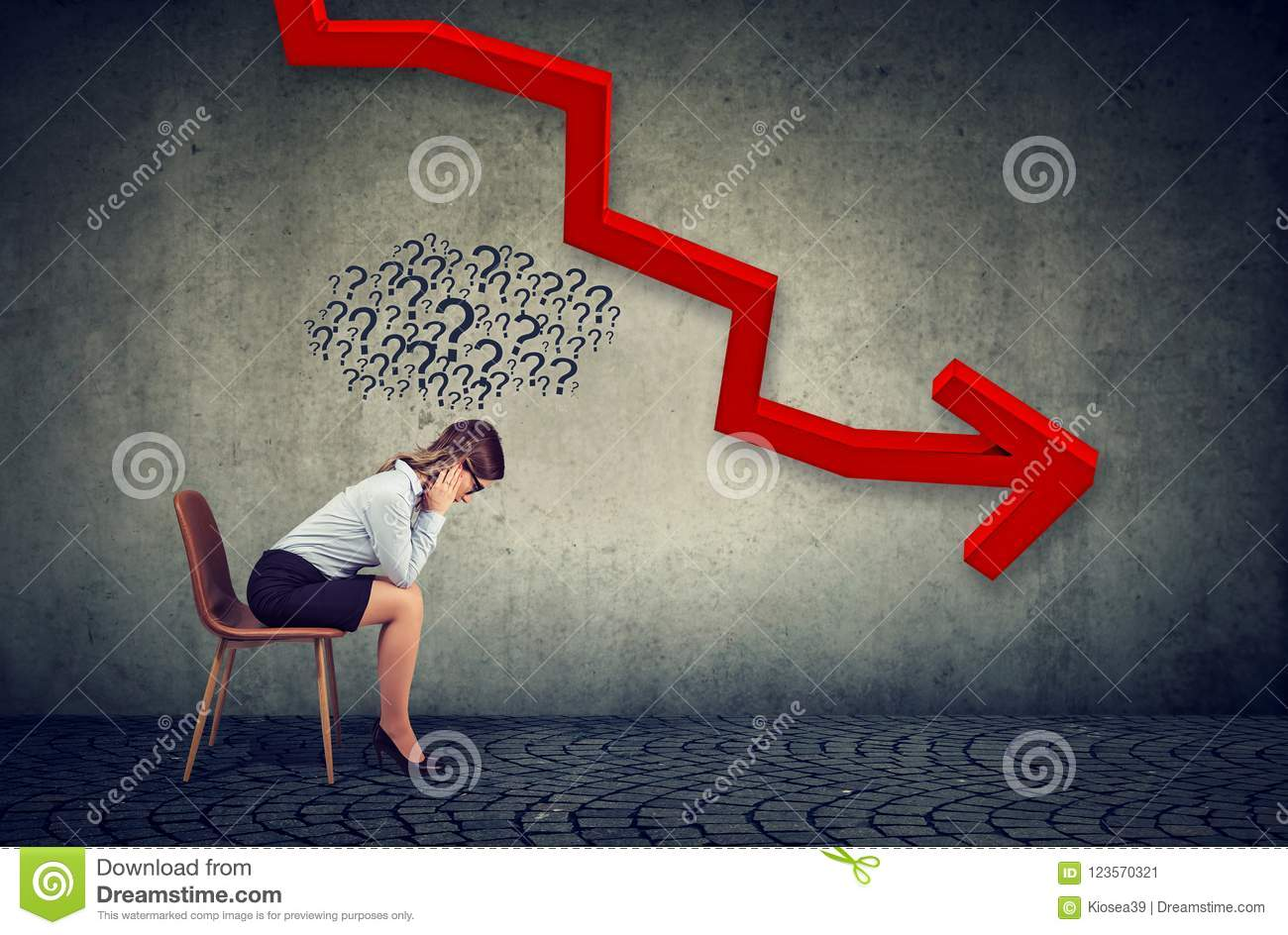 Depressed businesswoman looking down at the falling arrow feeling confused has many questions