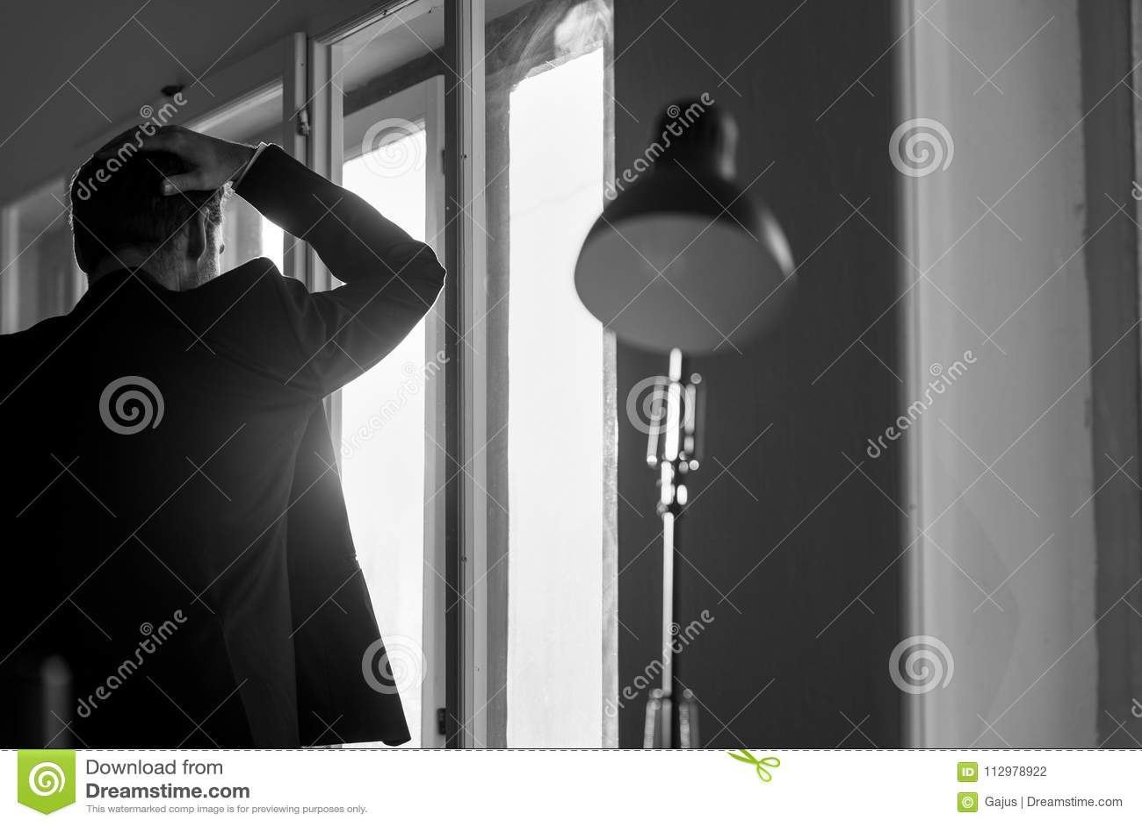 Depressed businessman in black business suit