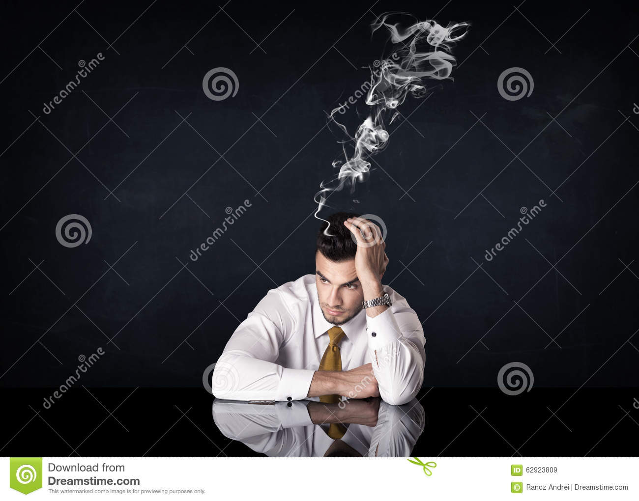 Depressed businessman with smoking head