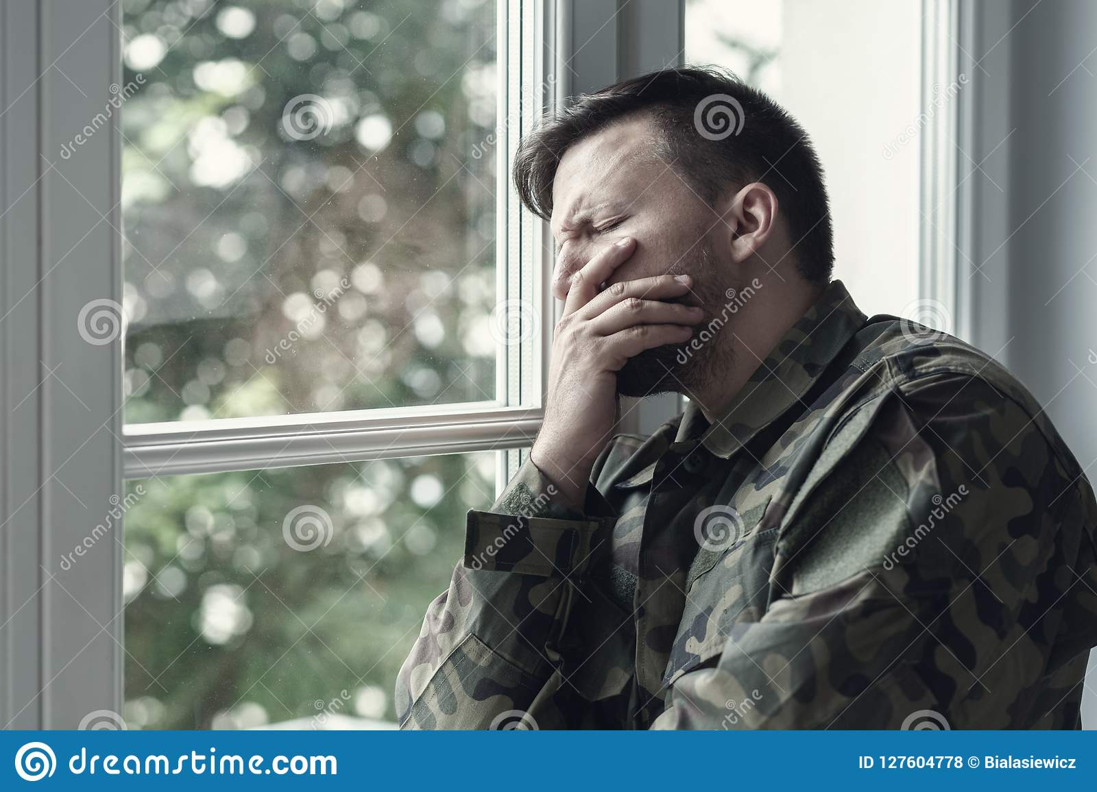 Depressed lonely soldier with emotional problem and war syndrome