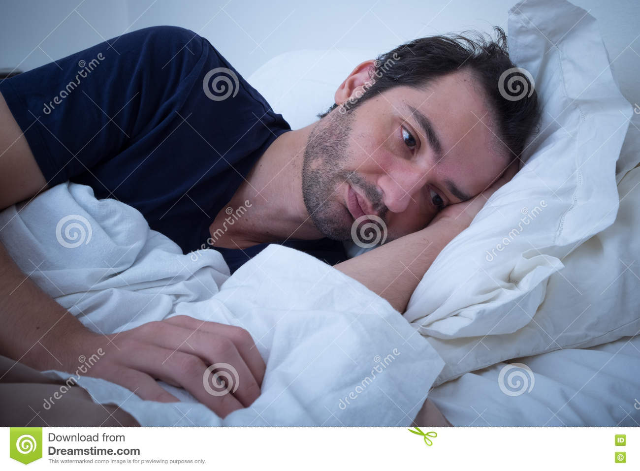 Depressed Man Lying In His Bed Stock Photo - Image of