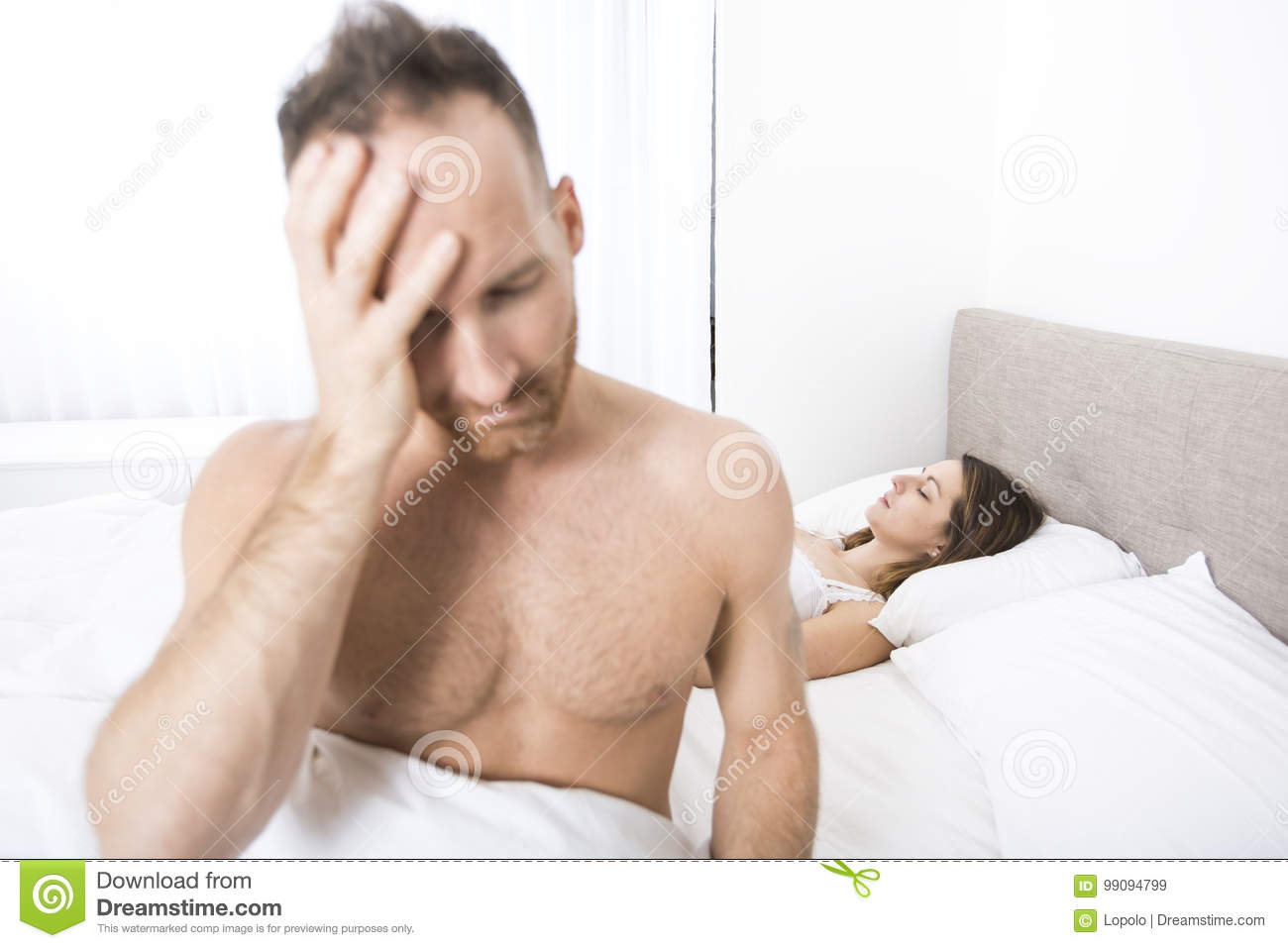 a97ca91d5b3 Depressed Man Sitting On The Edge Of The Bed In Bedroom Stock Image ...