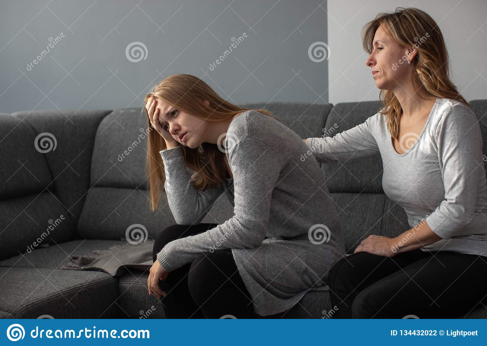 Depressed teen suffering from anxiety being taken care of by her mother