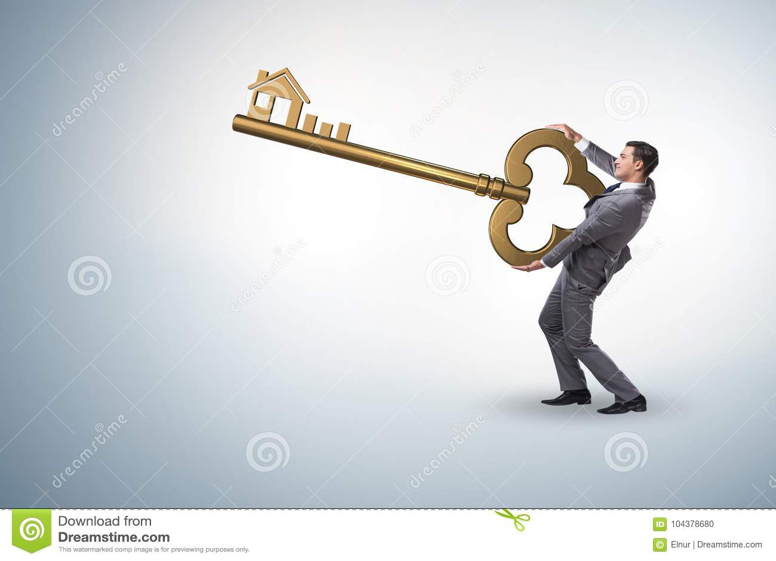 Der Geschäftsmann halten Schlüssel im Immobilienkonzept