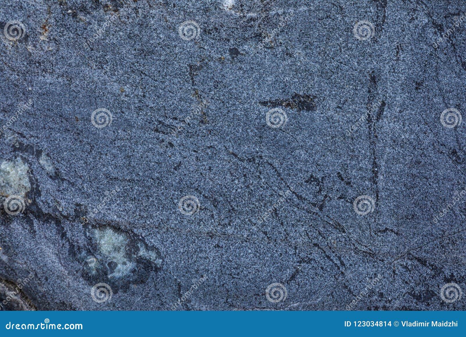Der Hintergrund oder die Beschaffenheit der Marmorwand des Steinbruchs oder das im Tagebau