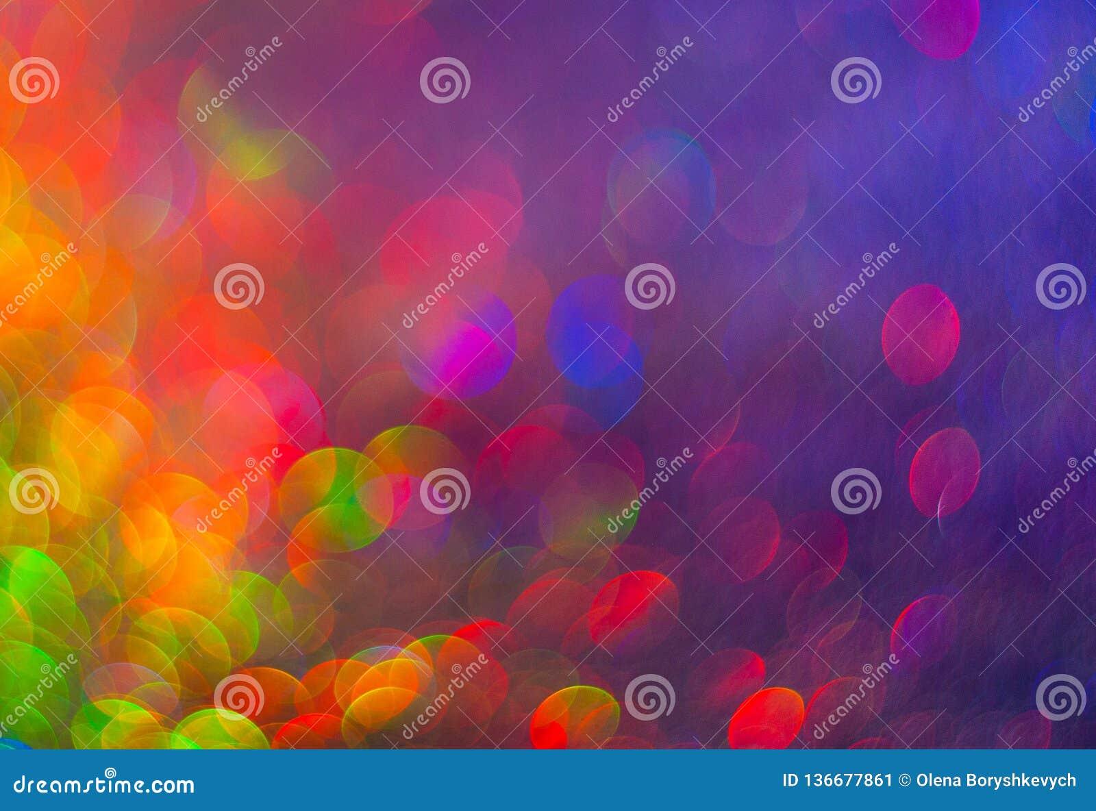 Der unfocused bunte Hintergrund von abstrakten Lichtern