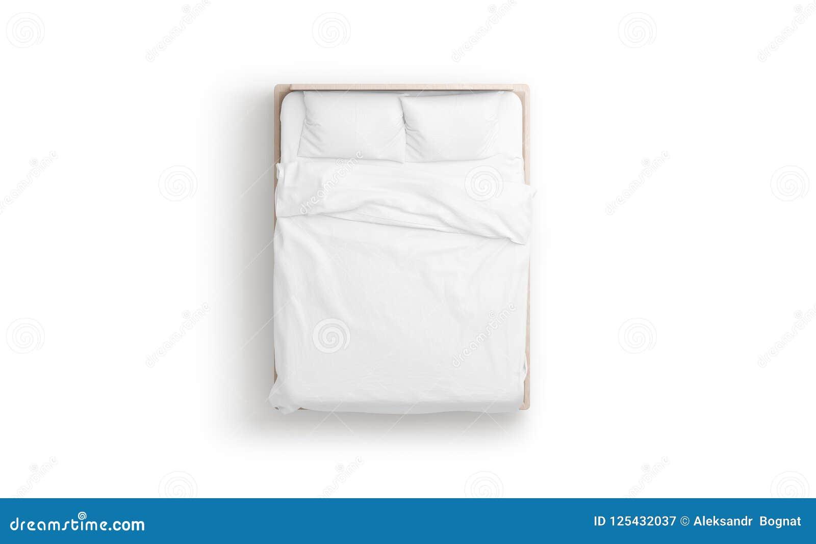 Derisione bianca in bianco del letto su, vista superiore isolata,