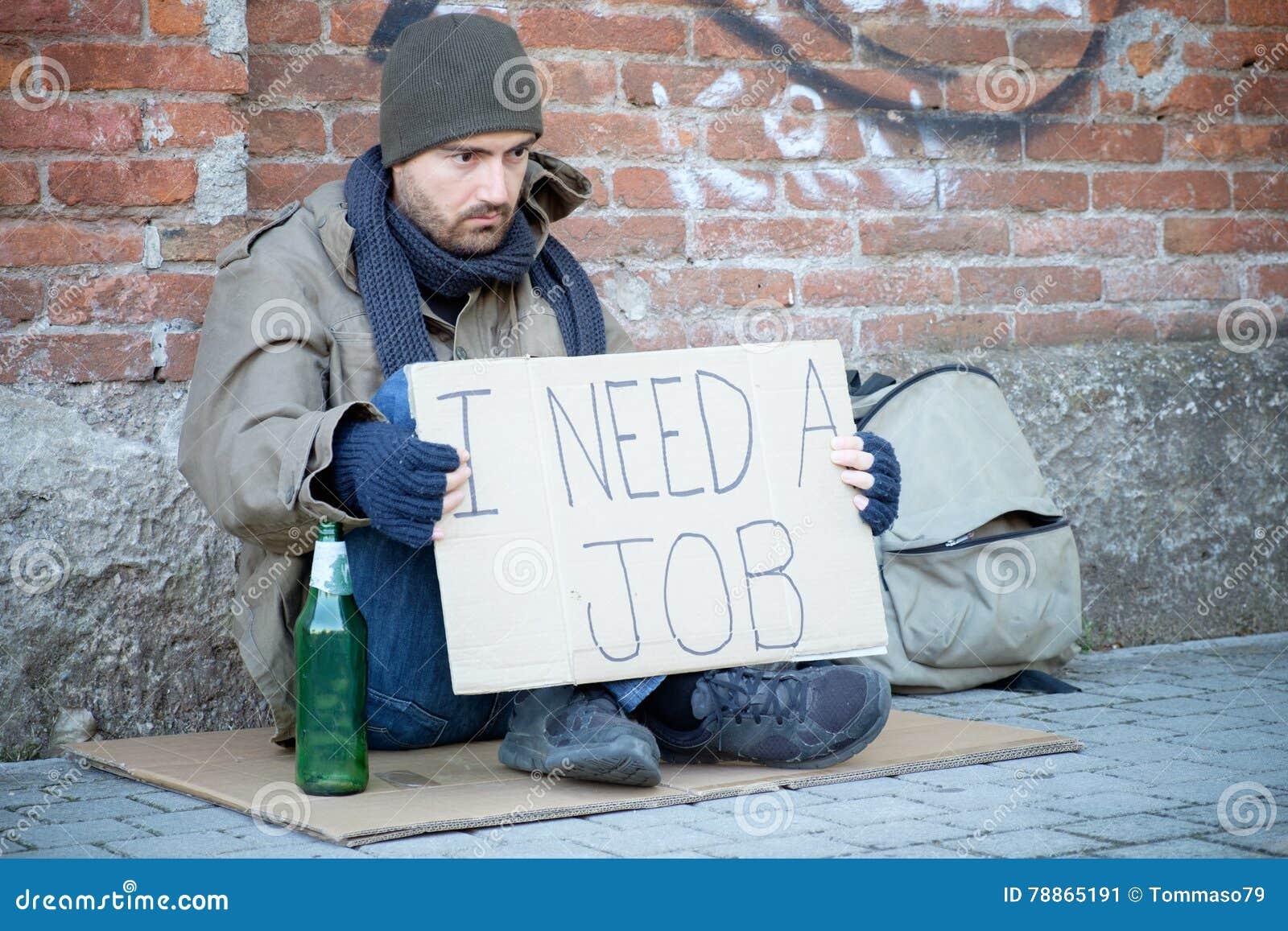 Desamparados asentados en la calle y pedir un trabajo