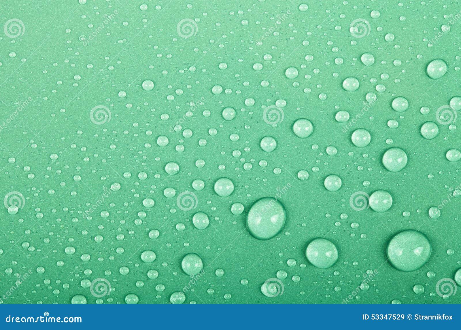 Descensos Del Agua En Un Fondo Del Color Verde Profundidad