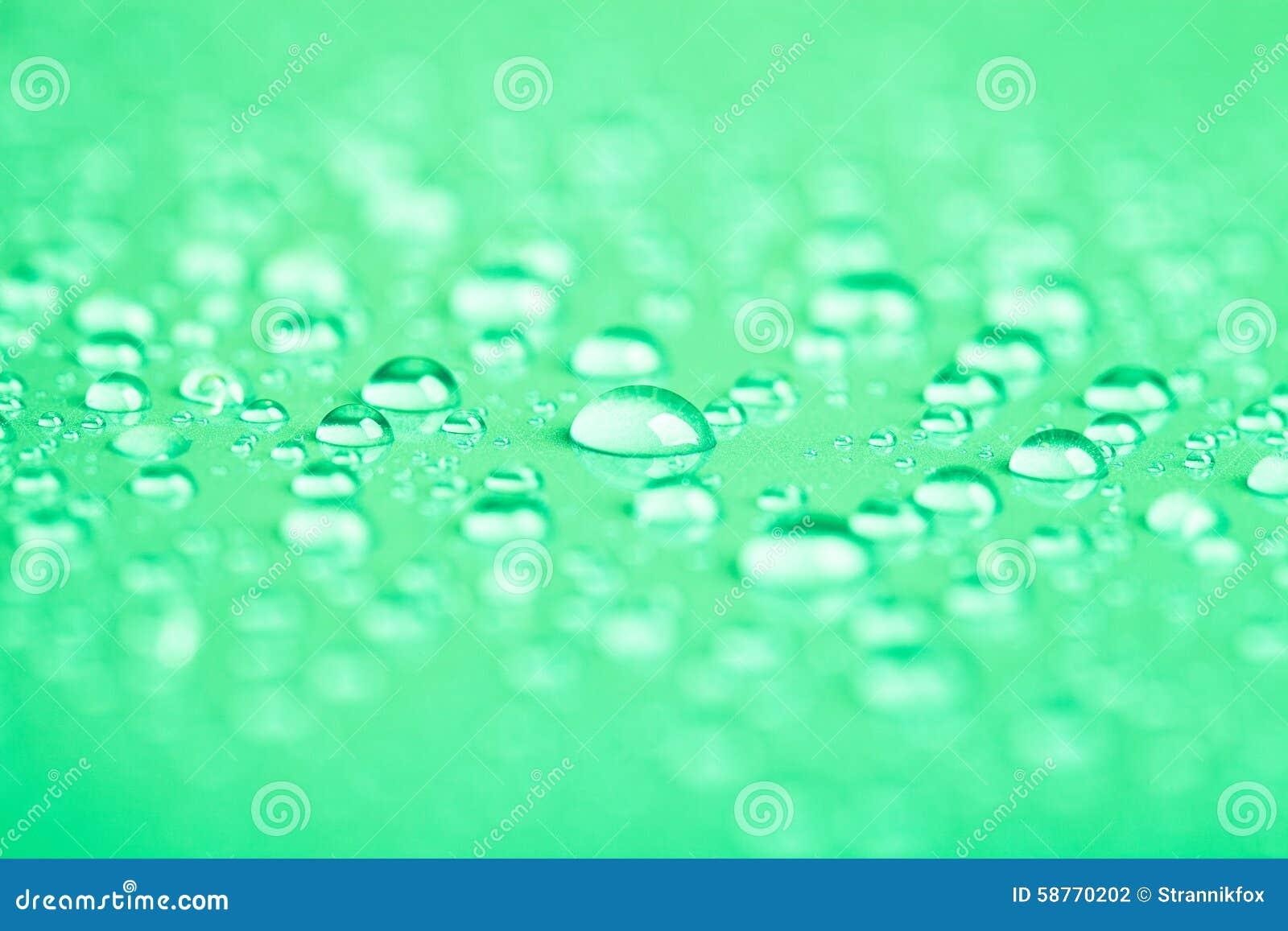 Fondos De Color Verde Agua: Descensos Del Agua En Un Fondo Del Color Verde Profundidad