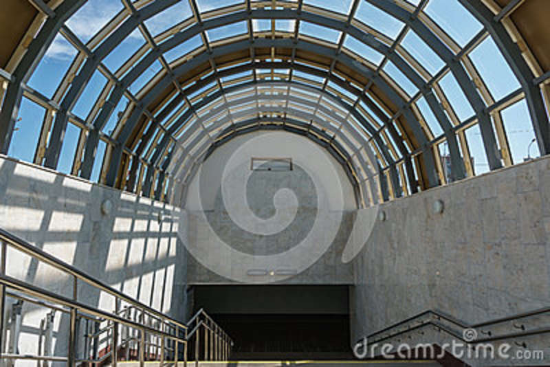 A Wide Staircase And A Glass Roof In The Form Of