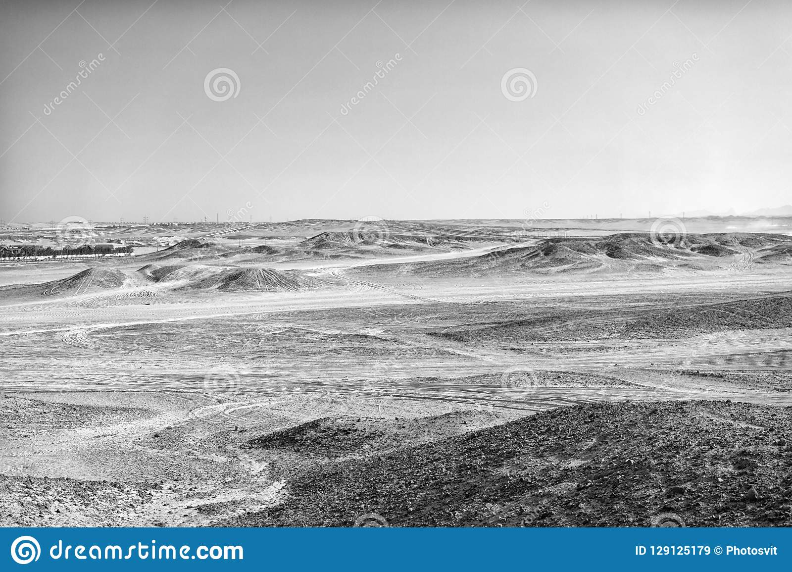 Desert landscape on clear blue sky background. Dune land with dry terrain surface. Ecology and global warming effect