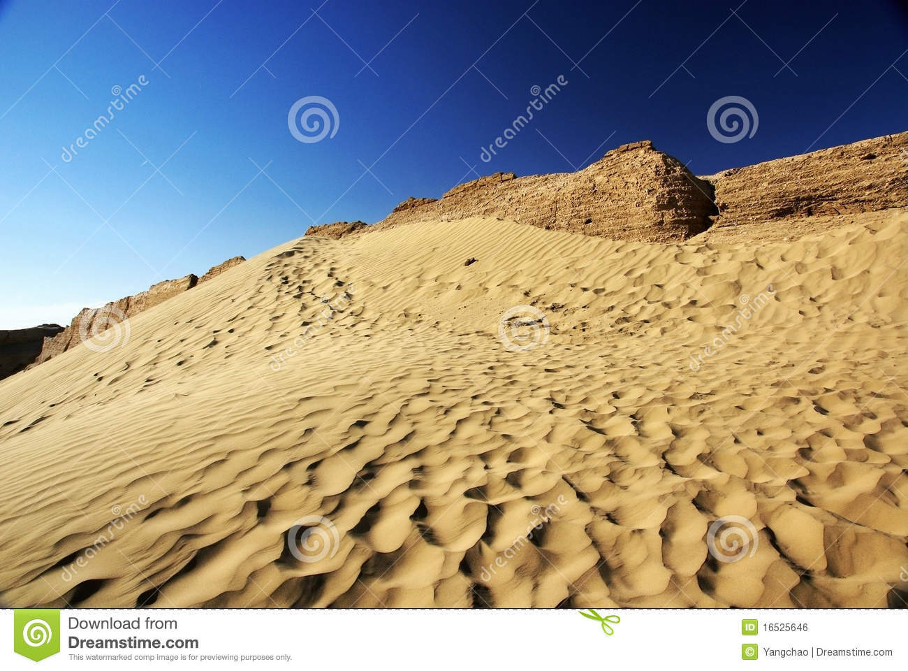 Desert with rotten ancient city wall