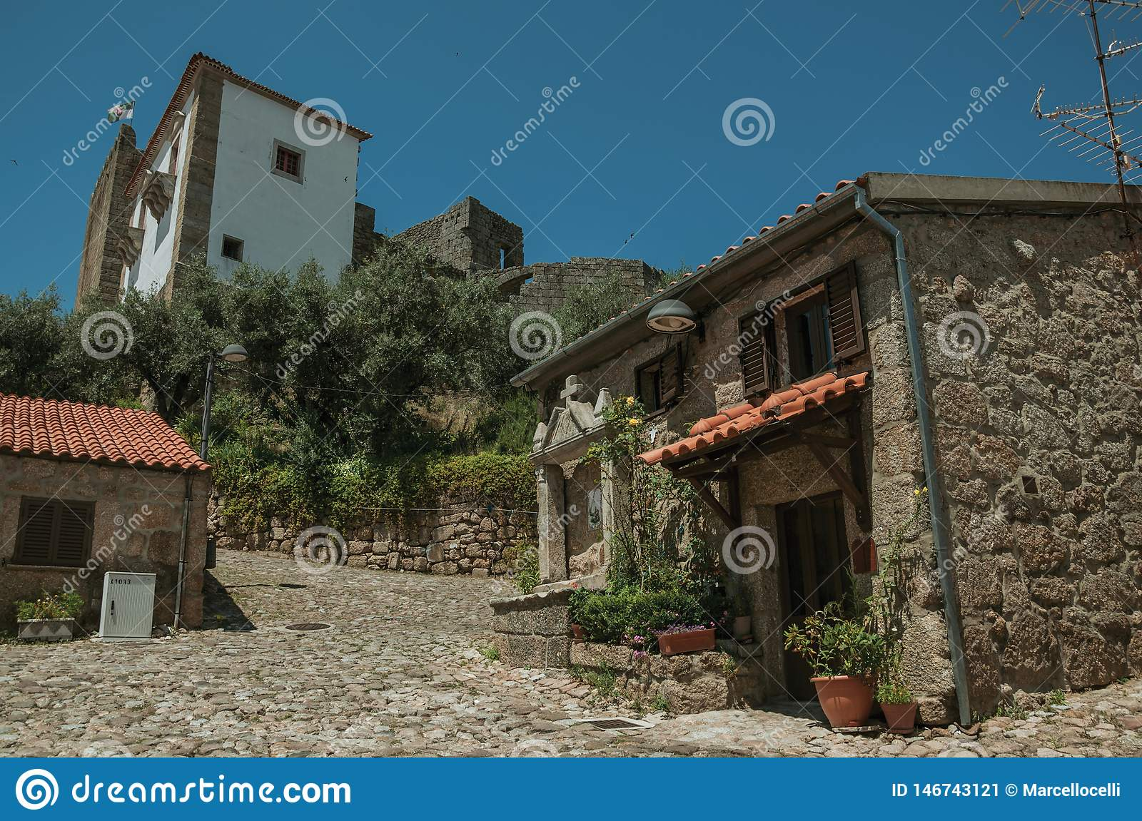 Deserted alley and old small house with stone walls