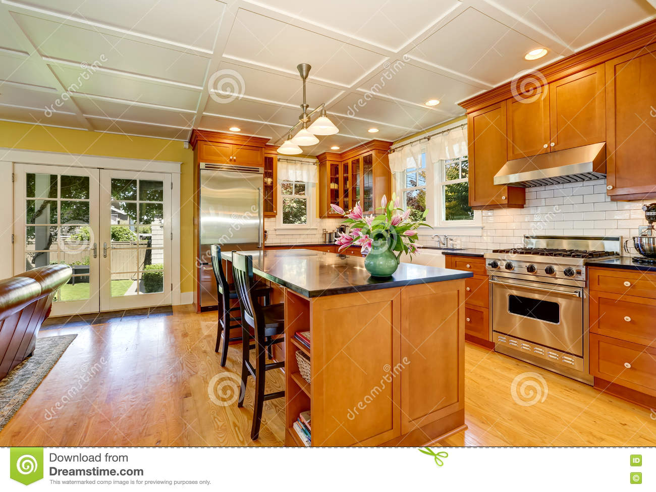 Design of brown wooden kitchen with steel appliances stock photo