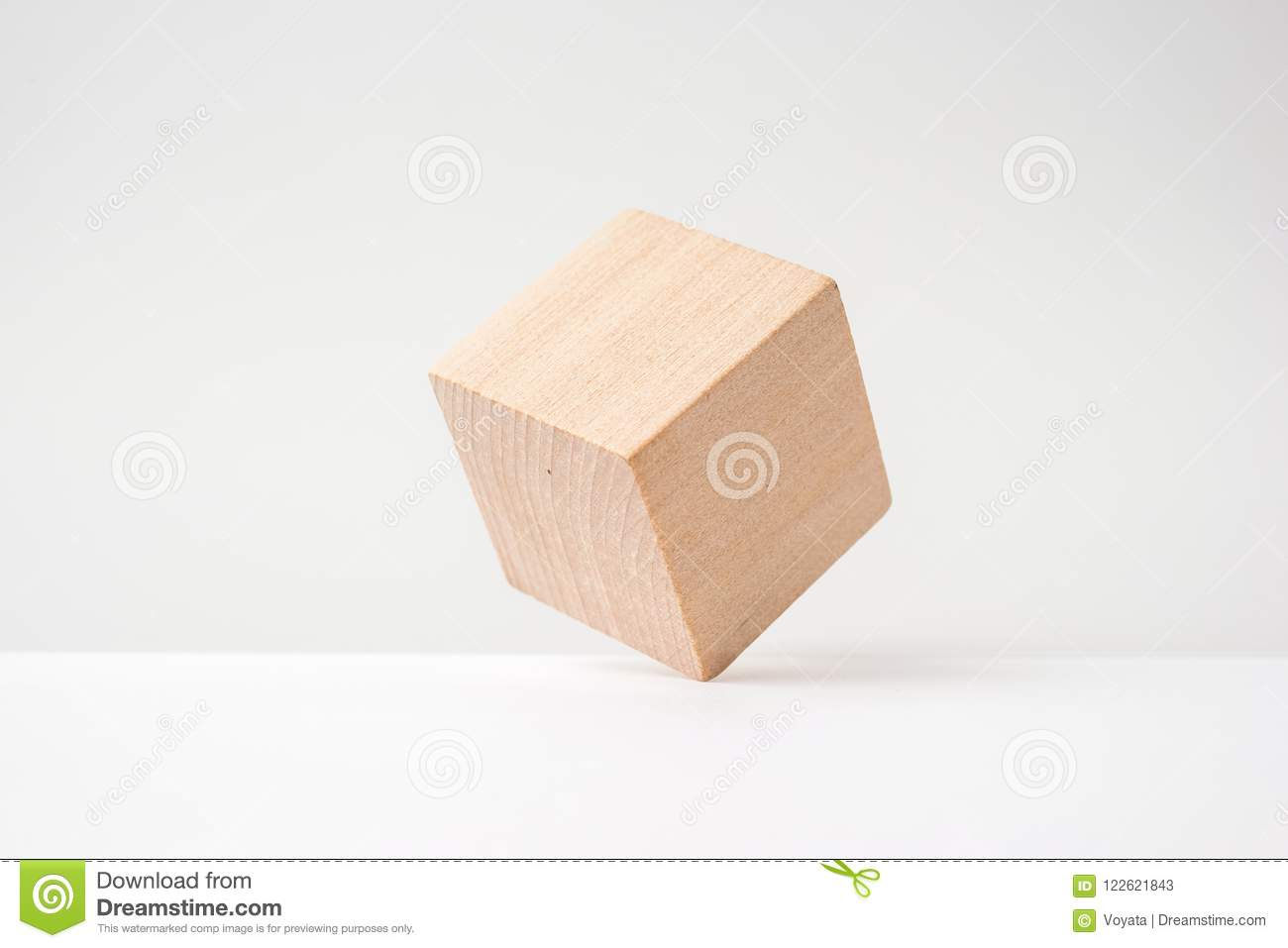 Abstract geometric real wooden cube with surreal layout on white background