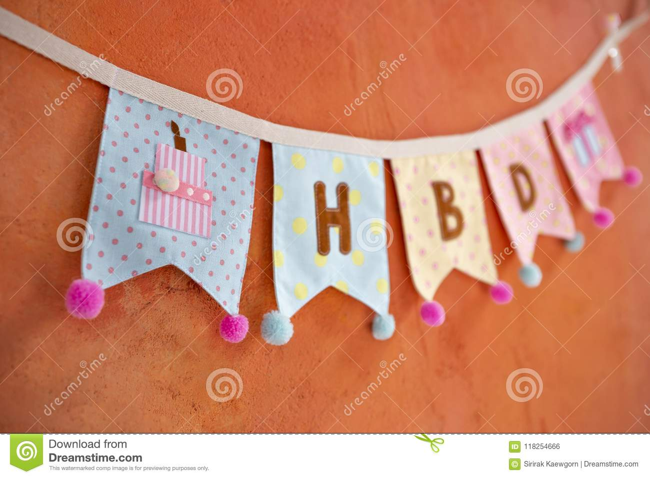 Design Fabric Birthday Party Flag Hanging On Orange Cement Wall